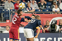 FOXBOROUGH, MA - SEPTEMBER 21: Brooks Lennon #12 of Real Salt Lake and Teal Bunbury #10 of New England Revolution compete for a high ball during a game between Real Salt Lake and New England Revolution at Gillette Stadium on September 21, 2019 in Foxborough, Massachusetts.