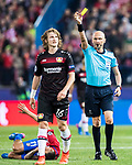 Referee Sergei Karasev shows Tin Jedvaj of Bayer 04 Leverkusen a yellow card during their 2016-17 UEFA Champions League Round of 16 second leg match between Atletico de Madrid and Bayer 04 Leverkusen at the Estadio Vicente Calderon on 15 March 2017 in Madrid, Spain. Photo by Diego Gonzalez Souto / Power Sport Images