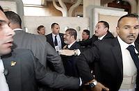 Il presidente egiziano Mohamed Morsi, al centro, circondato dalle guardie del corpo, lascia la Grande Moschea di Roma, 14 settembre 2012..Egyptian President Mohamed Morsi, center, surrounded by bodyguards, leaves after visiting the Great Mosque in Rome, 14 September 2012..UPDATE IMAGES PRESS/Riccardo De Luca