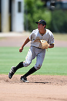 GCL Pirates shortstop Cole Tucker (17) tracks a fly ball during a game against the GCL Phillies on June 26, 2014 at the Carpenter Complex in Clearwater, Florida.  GCL Phillies defeated the GCL Pirates 6-2.  (Mike Janes/Four Seam Images)