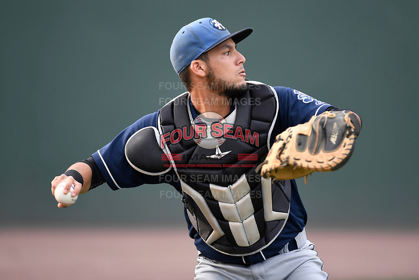 Catcher Joel Diaz (5) of the Asheville Tourists warms up before a game against the Greenville Drive on Wednesday, August 2, 2017, at Fluor Field at the West End in Greenville, South Carolina. Greenville won, 1-0. (Tom Priddy/Four Seam Images)