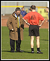 06/04/2002                 Copyright Pic : James Stewart .Ref :     .File Name : stewart-alloa v qos   07.WHILE ALLOA ASSISTANT GRAEME ARMSTRONG PREFERS TO WEAR SHORTS AND T-SHIRT IN THE SPRING SUN MANAGER CHRISTIE DECIDES IT WOULD BE BETTER TO WEAR HIS LUCKY DUFFLECOAT.......James Stewart Photo Agency, 19 Carronlea Drive, Falkirk. FK2 8DN      Vat Reg No. 607 6932 25.Office     : +44 (0)1324 570906     .Mobile  : + 44 (0)7721 416997.Fax         :  +44 (0)1324 630007.E-mail  :  jim@jspa.co.uk.If you require further information then contact Jim Stewart on any of the numbers above.........