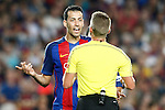FC Barcelona's Sergio Busquets have words with the referee during Supercup of Spain 2nd match.August 17,2016. (ALTERPHOTOS/Acero)