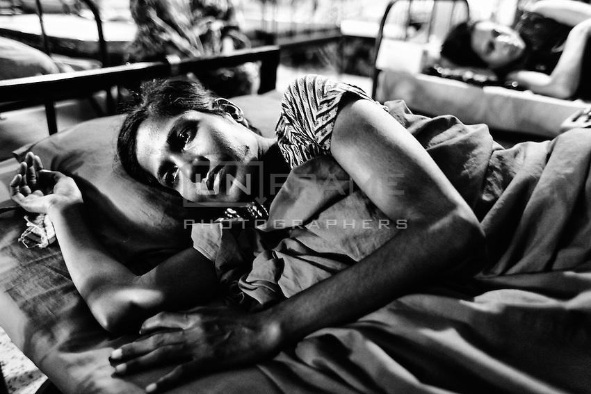 Roksana is 30 years old female. She was working as garments worker at Rana Plaza. During the disaster the roof collapsed on the table she was working at and the table smashed on her waist. Her back bone is broken. Savar, near Dhaka, Bangladesh