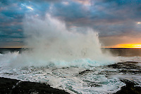 High surf, the last glow of sunset and an overcast sky at Keahole Point, Hawai'i Island.
