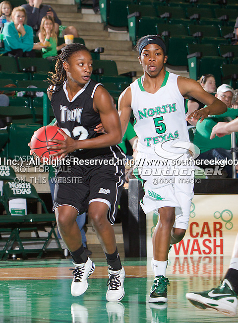 Troy Trojans guard DeAngela Sword (22) and North Texas Mean Green guard Brittney Hudson (5) in action during the game between the Troy Trojans and the University of North Texas Mean Green at the North Texas Coliseum,the Super Pit, in Denton, Texas. UNT defeats Troy 57 to 36.