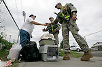 Louisiana Army National Guard members Don Gatheright (R) and Eric Chism (C) help Arthur Olstein and his two cats to a fire station on St Claude St in New Orleans for evacuation prior to the arrival of Hurricane Gustav August 31, 2008.    (Mark Wallheiser/TallahasseeStock.com)