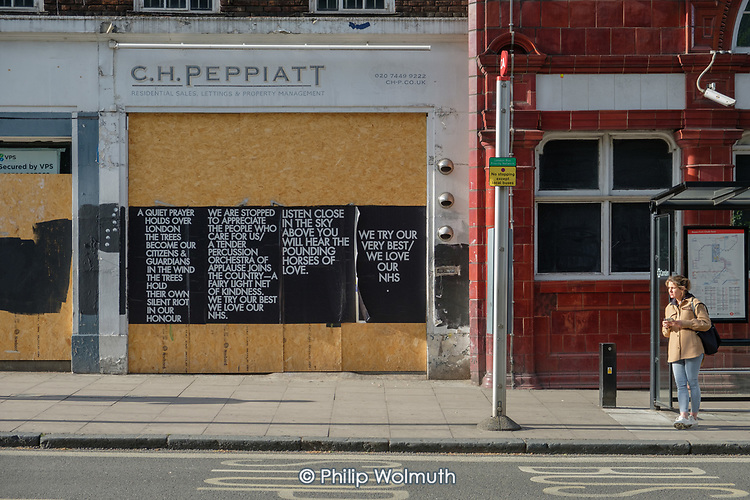 Covid-19 pandemic.  Flyposted We Love Our NHS poem.  Closed shops and businesses in Chalk Farm, London, during the coronavirus lockdown.