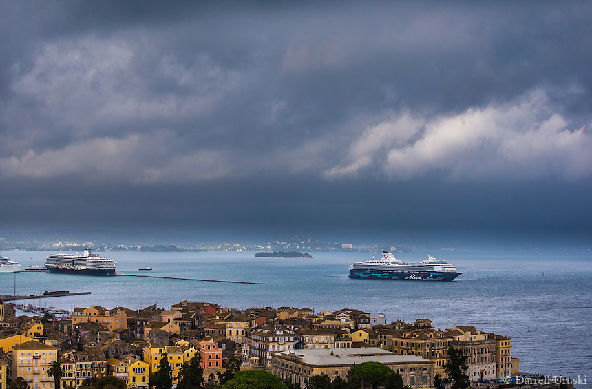 Fine Art Landscape Photograph of the Coastline of Corfu, Greece on a stormy day. The Colourful buildings and the cruise ships balance the drama of the dramatic cloud filled sky.