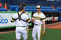 Michigan Wolverines catcher Harrison Wenson (7) shakes hands with starting pitcher Ryan Nutof (8) after warming up in the bullpen before the first game of a doubleheader against the Canisius College Golden Griffins on June 20, 2016 at Tradition Field in St. Lucie, Florida.  Michigan defeated Canisius 6-2.  (Mike Janes/Four Seam Images)