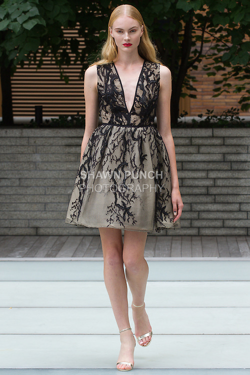 Model walks runway in an outfit from the Rita Vinieris Spring 2016 collection, on the Carnegie Hall Rooftop Garden, during New York Fashion Week Spring 2016.