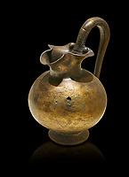 Phrygian bronze trefoil spouted jug from Gordion . Phrygian Collection, 8th century BC - Museum of Anatolian Civilisations Ankara. Turkey. Against a black background