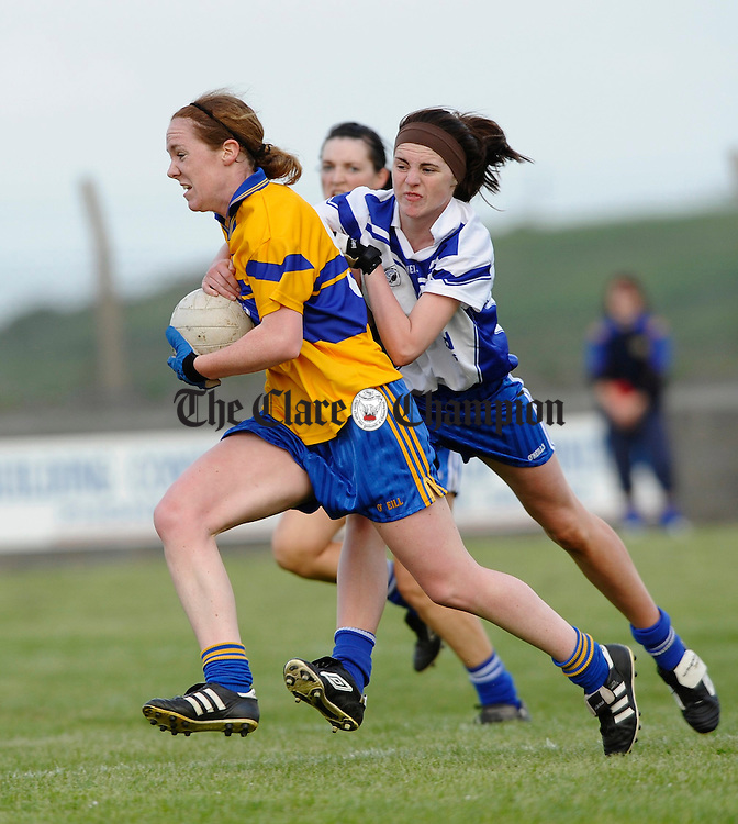 The Banner's Louise Henchy is tackled by Ciara Harvey of West Clare Gaels  during the Ladies Football Division 1 final at Quilty. Photograph by John Kelly.