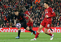 Atletico Madrid's Angel Correa under pressure from Liverpool's Sadio Mane and Trent Alexander-Arnold (right)<br /> <br /> Photographer Rich Linley/CameraSport<br /> <br /> UEFA Champions League Round of 16 Second Leg - Liverpool v Atletico Madrid - Wednesday 11th March 2020 - Anfield - Liverpool<br />  <br /> World Copyright © 2020 CameraSport. All rights reserved. 43 Linden Ave. Countesthorpe. Leicester. England. LE8 5PG - Tel: +44 (0) 116 277 4147 - admin@camerasport.com - www.camerasport.com