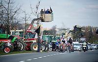 breakaway group riding through a farmers protest <br /> <br /> 99th Ronde van Vlaanderen 2015