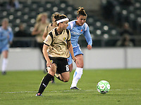 Tiffany Weimer (8) of FC Gold Pride cuts the ball inside with Megan Schnurr (12) of Sky Blue in pursuit.  Sky Blue FC and FC Gold Pride battled to a 1-1 draw in Bridgewater, NJ on Saturday, April 11, 2009.