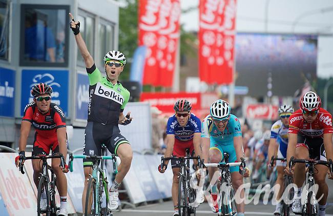 stage winner Paul Martens (DEU/Belkin) celebrates his stage victory while his teammate Sep Vanmarcke (BEL/Belkin) crashes just in front of the finishline behind him<br /> <br /> 2014 Belgium Tour<br /> (final) stage 5: Oreye - Oreye (179km)