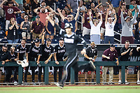 Mississippi State Bulldogs crowd and bench celebrate as the winning run crosses the plate in Game 4 of the NCAA College World Series against the Auburn Tigers on June 16, 2019 at TD Ameritrade Park in Omaha, Nebraska. Mississippi State defeated Auburn 5-4. (Andrew Woolley/Four Seam Images)