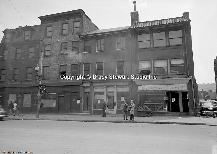 Pittsburgh PA:  View of the city of Pittsburgh before Gateway Center.  The corner of Liberty Avenue and 4th Avenue where vacant buildings were going to be torn down.