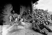 Marines of the 1st Marine Division relax by a Korean hut after destroying an enemy sniper housed there.  September 24, 1951.  T. Sgt. Frank  W. Sewell. (Marine Corps)<br /> NARA FILE #:  127-N-A156980<br /> WAR & CONFLICT BOOK #:  1391