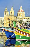 - church and fishing boats in the fishermen village of Marsaxlokk....- chiesa e pescherecci nel villaggio di pescatori di Marsaxlokk