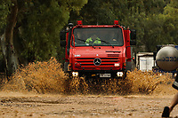Pictured: A fire service vehicle travels through the flood.<br /> Re: Five people have reportedly died and severe damage caused by heavy rain and flash flooding in the area of Mandra, near Athens, Greece. Wednesday 15 November 2017