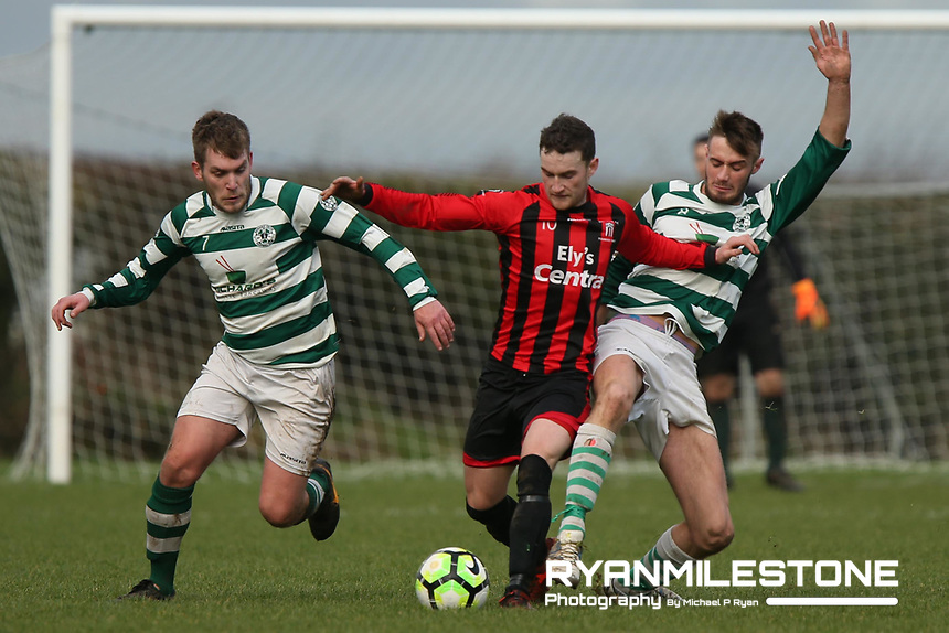Peake Villa's Stephen Carroll in action against Nenagh Celtic's Brendan Sheehan and Jamie Kelly during the Munster Junior Cup 4th Round at Tower Grounds, Thurles, Co Tipperary on Sunday 28th January 2018, Photo By: Michael P Ryan