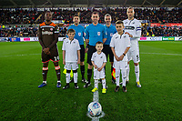 Romaine Sawyers of Brentford and Mike van der Hoorn of Swansea City with the mascots during the Sky Bet Championship match between Swansea City and Brentford at the Liberty Stadium in Swansea, Wales, UK. Tuesday 02 April 2019