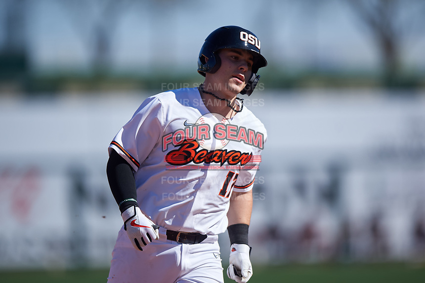 Oregon State Beavers Troy Claunch (17) rounds the bases after hitting a home run during an NCAA game against the New Mexico Lobos at Surprise Stadium on February 14, 2020 in Surprise, Arizona. (Zachary Lucy / Four Seam Images)