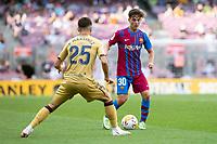 26th September 2021;   Nou Camp, Barcelona, Spain: La Liga football, FC Barcelona versus Levante: Gavi of Barcelona takes on Martinez of Levante