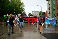 The 'Stop The Station' protest marches through East Liberty calling for the Pittsburgh Police to stay out of the neighborhood on Tuesday August 4, 2020 in Pittsburgh, Pennsylvania. (Photo by Jared Wickerham/Pittsburgh City Paper)