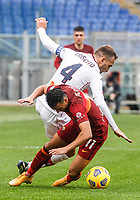 Roma's Pedro, foreground, is challenged by Genoa's Domenico Criscito during the Italian Serie A Football match between Roma and Genoa at Rome's Olympic stadium, March 7, 2021.<br /> UPDATE IMAGES PRESS/Riccardo De Luca