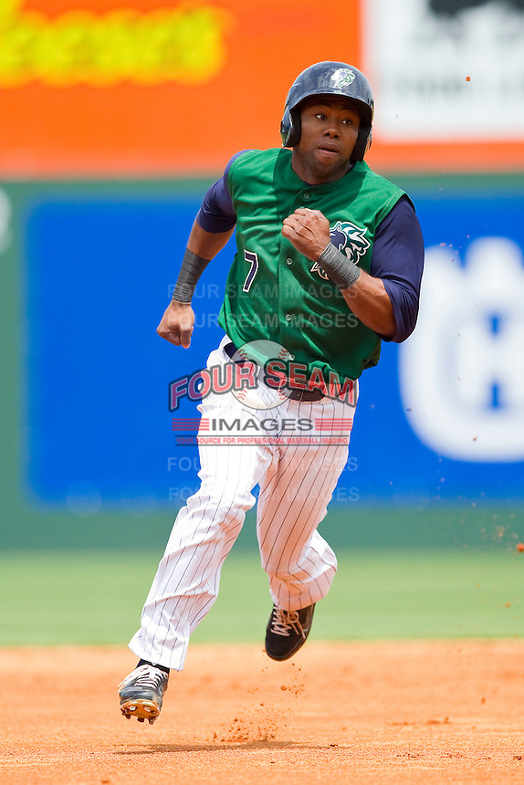 Alejandro De Aza #7 of the Charlotte Knights hustles towards third base against the Syracuse Chiefs at Knights Stadium on June 19, 2011 in Fort Mill, South Carolina.  The Knights defeated the Chiefs 10-9.    (Brian Westerholt / Four Seam Images)