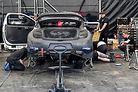 Mechanics working on Mark Donnely's vehicle between races during the 5 Nations BRX Championship at Lydden Hill Race Circuit on 31st May 2021