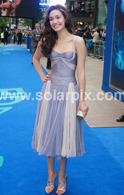 **ALL ROUND PICTURES FROM SOLARPIX.COM**.**WORLDWIDE SYNDICATION RIGHTS**.Emmy Rossum at the UK premiere of 'Poseidon' held at the Empire in Leicester Square, London, UK 28th May 2006..JOB REF: 4999  BNE       DATE: 28_05_2006.**MUST CREDIT SOLARPIX.COM OR DOUBLE FEE WILL BE CHARGED* *UNDER NO CIRCUMSTANCES IS THIS IMAGE TO BE REPRODUCED FOR ANY ONLINE EDITION WITHOUT PRIOR PERMISSION*