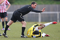 Referee John Hopkins signals that Sanchez Ming of Bromley does not need attention from the physio - AFC Hornchurch vs Bromley - Blue Square Conference South Football at The Stadium, Upminster Bridge, Essex - 01/04/13 - MANDATORY CREDIT: Gavin Ellis/TGSPHOTO - Self billing applies where appropriate - 0845 094 6026 - contact@tgsphoto.co.uk - NO UNPAID USE.