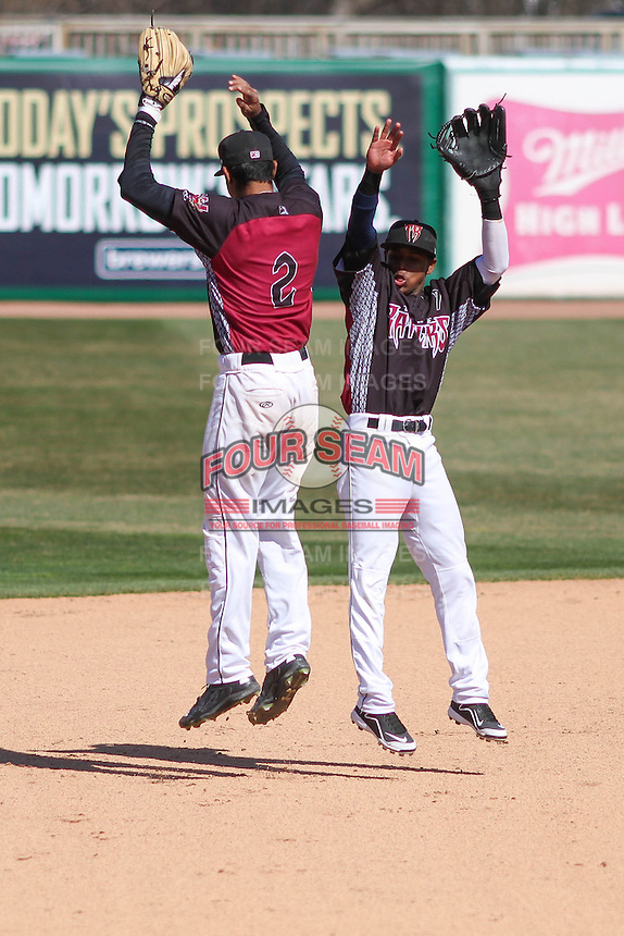 Wisconsin Timber Rattlers shortstop Jake Gatewood (2) and second baseman Gregory Munoz (7) celebrate a victory during a game against the Peoria Chiefs on April 25th, 2015 at Fox Cities Stadium in Appleton, Wisconsin.  Wisconsin defeated Peoria 2-0.  (Brad Krause/Four Seam Images)