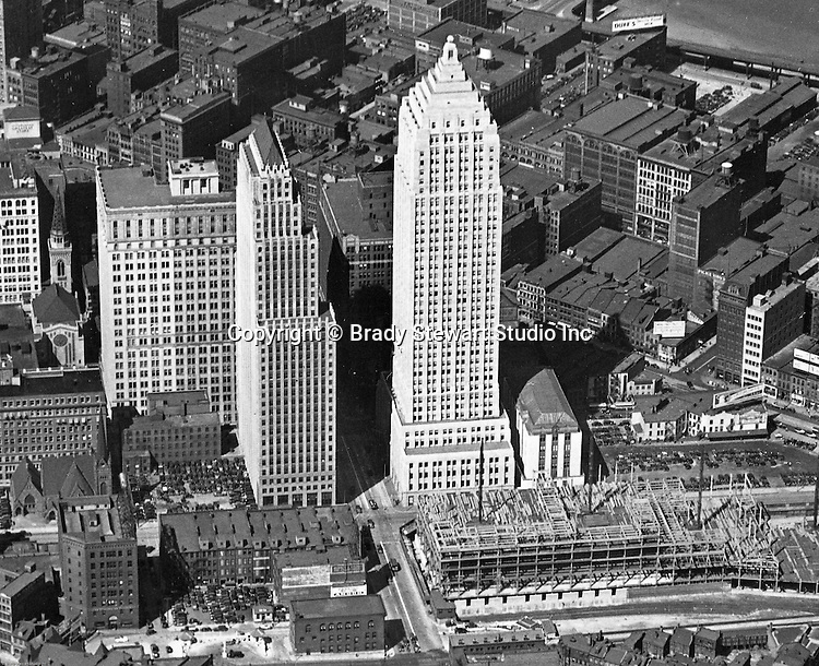 Pittsburgh PA:  View of the new Gulf Building and construction of the Post Office Federal Courts building.  Construction started in 1930 and completed in 1932. The building has 44 floors and was the largest building in Pittsburgh until 1970.<br /> <br /> Other buildings in the image include Koppers Building, Bell Telephone Building, William Penn Hotel, and First Lutheran Church (bottom left).