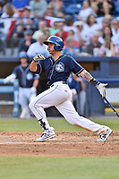 Asheville Tourists designated hitter Colton Welker (24) swings at a pitch during a game against the Greenville Drive at McCormick Field on April 15, 2017 in Asheville, North Carolina. The Tourists defeated the Drive 5-4. (Tony Farlow/Four Seam Images)