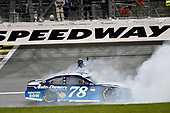 Monster Energy NASCAR Cup Series<br /> Go Bowling 400<br /> Kansas Speedway, Kansas City, KS USA<br /> Saturday 13 May 2017<br /> Martin Truex Jr, Furniture Row Racing, Auto-Owners Insurance Toyota Camry celebrates his win with a burnout<br /> World Copyright: Nigel Kinrade<br /> LAT Images<br /> ref: Digital Image 17KAN1nk10343