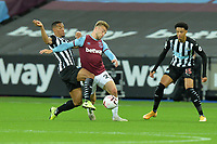 Isaac Hayden of Newcastle United tackles Jarrod Bowen of West Ham United during West Ham United vs Newcastle United, Premier League Football at The London Stadium on 12th September 2020