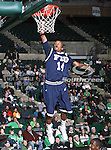 Florida International University Panthers guard DeJuan Wright (14) gets a slam dunk in the NCAA  basketball game between the Florida International University Panthers and the University of North Texas Mean Green at the North Texas Coliseum,the Super Pit, in Denton, Texas. UNT defeated FIU 87 to 77