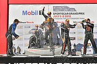 #77 Compass Racing, Audi RS3 LMS TCR, TCR: Britt Casey Jr, Tom Long celebrates the win on the podium #54 JDC-Miller MotorSports, Audi RS3 LMS TCR, TCR: Michael Johnson, Stephen Simpson, #75 SunEnergy1 Racing Mercedes AMG GT3, GTD: Kenny Habul, Mikael Grenier