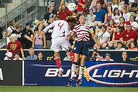 Abby Wambach (20) of the United States (USA) and Li Jiayue (4) of China PR (CHN). The United States (USA) women defeated China PR (CHN) 4-1 during an international friendly at PPL Park in Chester, PA, on May 27, 2012.