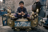 Child employed at shoe shine stand in Istanbul Turkey - Child labor as seen around the world between 1979 and 1980 - Photographer Jean Pierre Laffont, touched by the suffering of child workers, chronicled their plight in 12 countries over the course of one year.  Laffont was awarded The World Press Award and Madeline Ross Award among many others for his work.