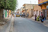 Senegal, Saint Louis.  Street Scene.  Shops and Residences Sit Side by Side.