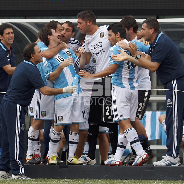 Argentina forward  Lionel Messi (10) celebrates third of his three goal effort with team bench. In an international friendly (Clash of Titans), Argentina defeated Brazil, 4-3, at MetLife Stadium on June 9, 2012.