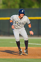 Nick Ciuffo (14) of the Princeton Rays takes his lead off of first base against the Burlington Royals at Burlington Athletic Park on July 11, 2014 in Burlington, North Carolina.  The Rays defeated the Royals 5-3.  (Brian Westerholt/Four Seam Images)