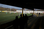 Prescot Cables 2 Brighouse Town 1, 13/02/2016. Hope Street, Northern Premier League. Spectators behind the goal watching the first-half action as Prescot Cables (in orange) take on Brighouse Town in a Northern Premier League division one north fixture at Valerie Park. Founded in 1884, the 'Cables' in their name came from the largest local employer, British Insulated Cables and they have played in their current ground, also known as Hope Street, since 1906. Prescott won the match 2-1 watched by a crowd of 189. Photo by Colin McPherson.