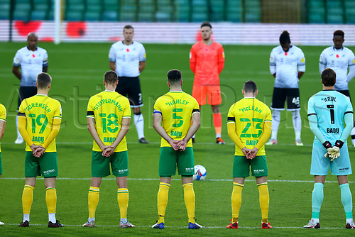 7th November 2020; Carrow Road, Norwich, Norfolk, England, English Football League Championship Football, Norwich versus Swansea City; Norwich City captain Grant Hanley stands with his team mates during the minutes silence for remembrance Sunday